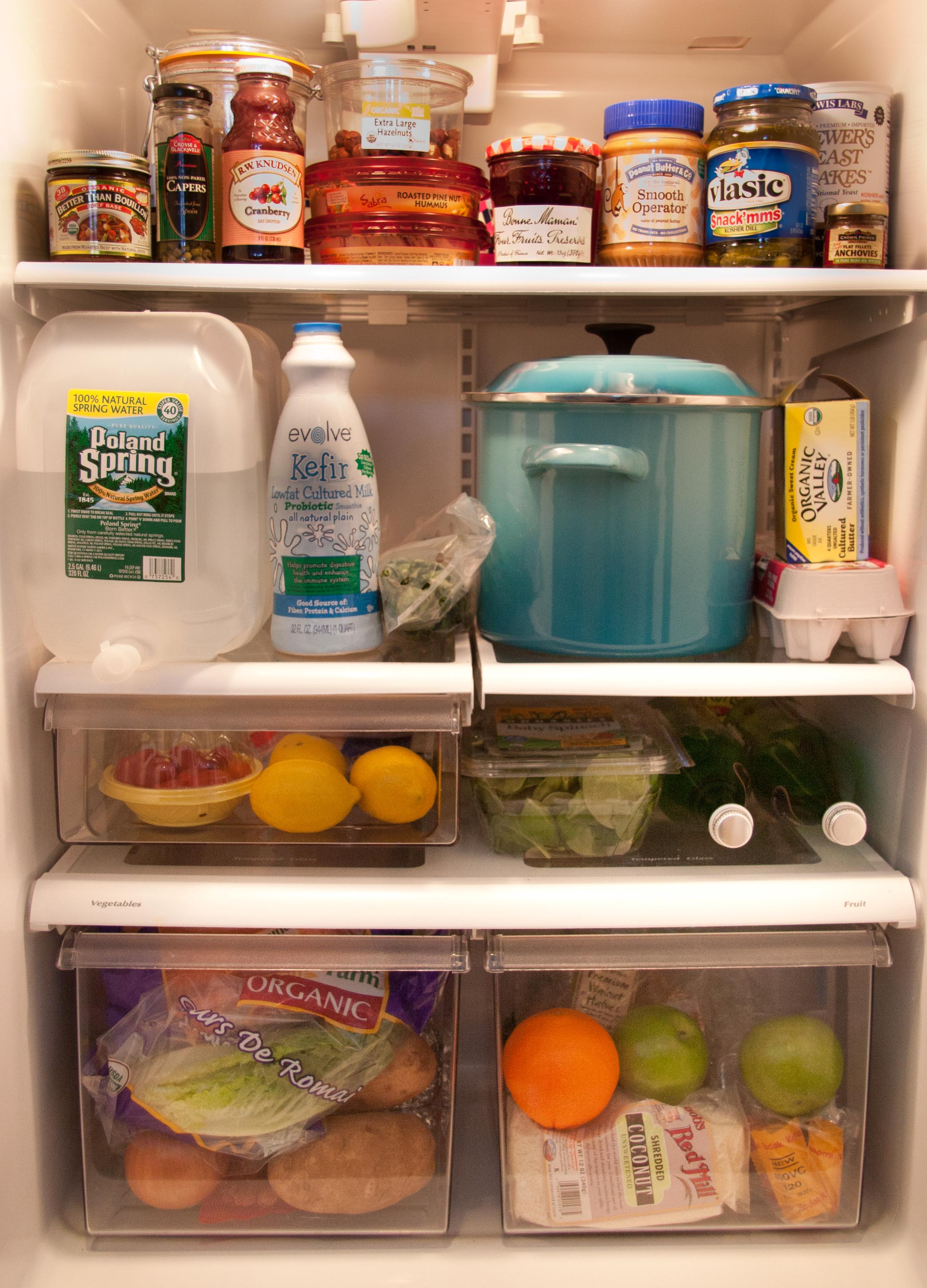 the inside of a well stocked fridge