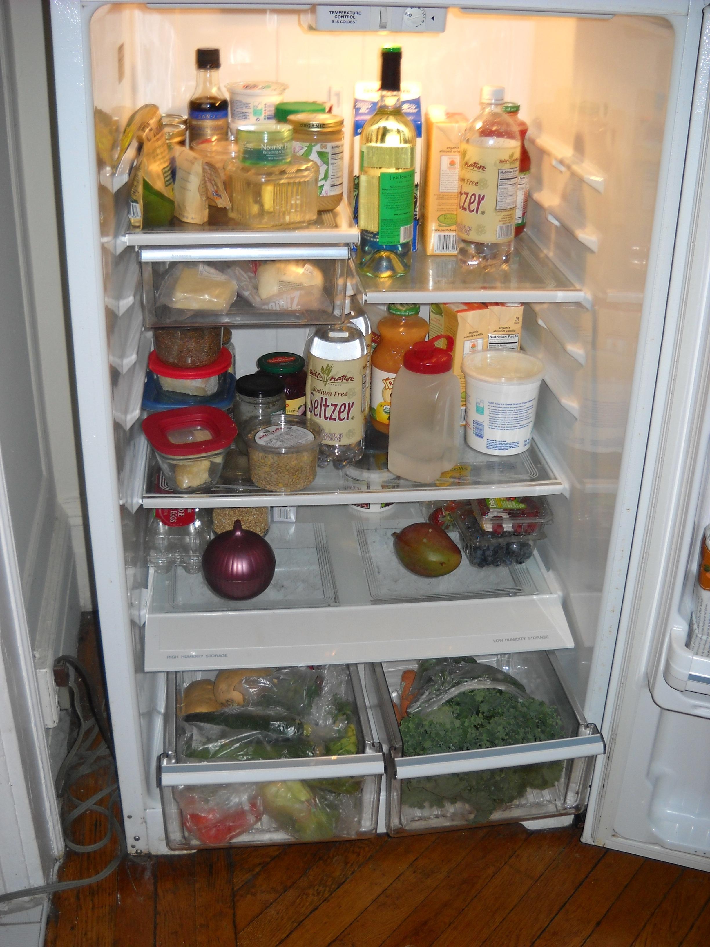 An open, well stocked fridge