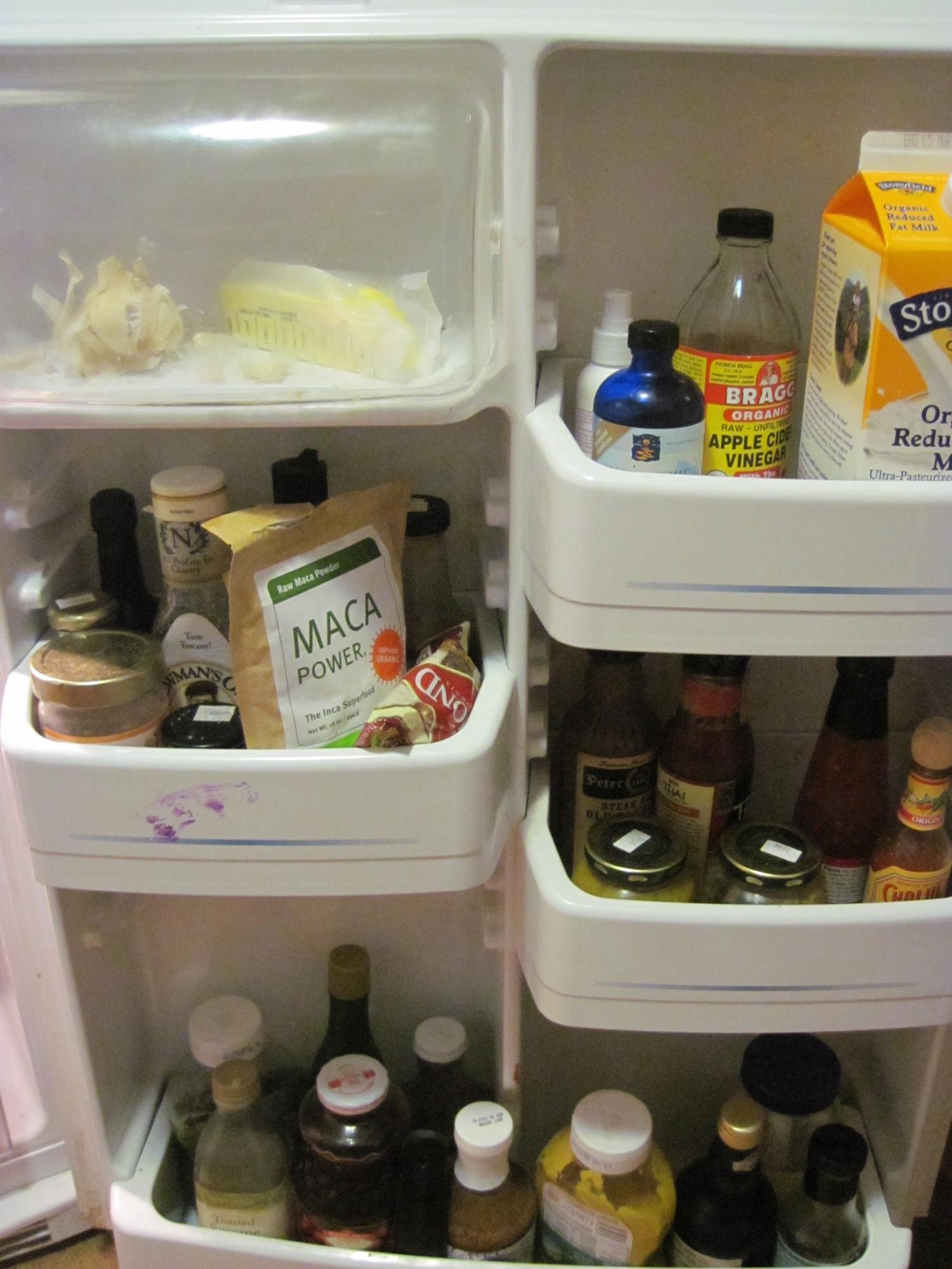 A close up of full fridge shelves