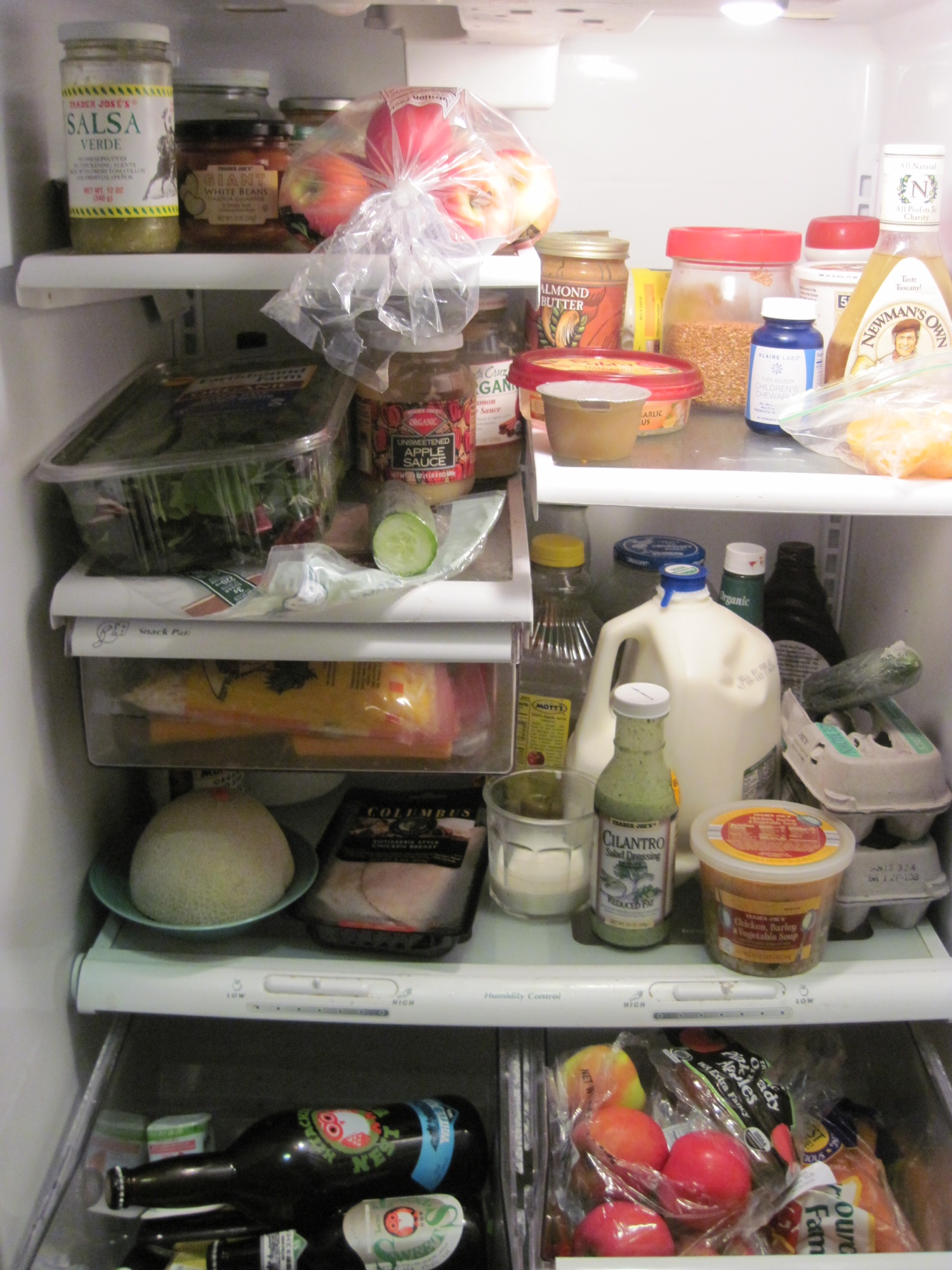a close up of a well stocked fridge