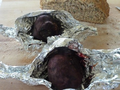 beets in opened tin foil boat out of the oven