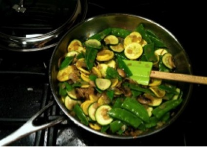mushrooms, zucchini, and green snap peas in a pan