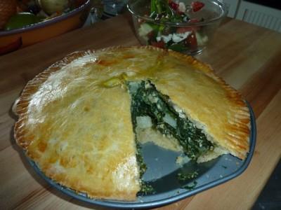 Photo of leafy green pie cut open