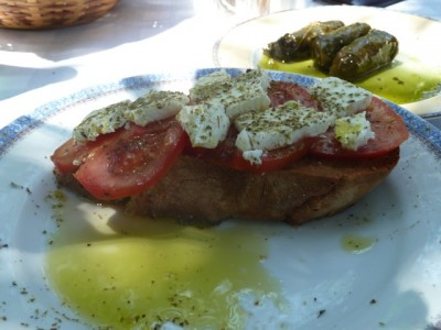 greek inspired chicken dish and grape leaves