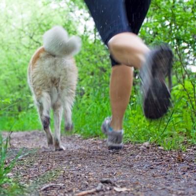 woman running dog