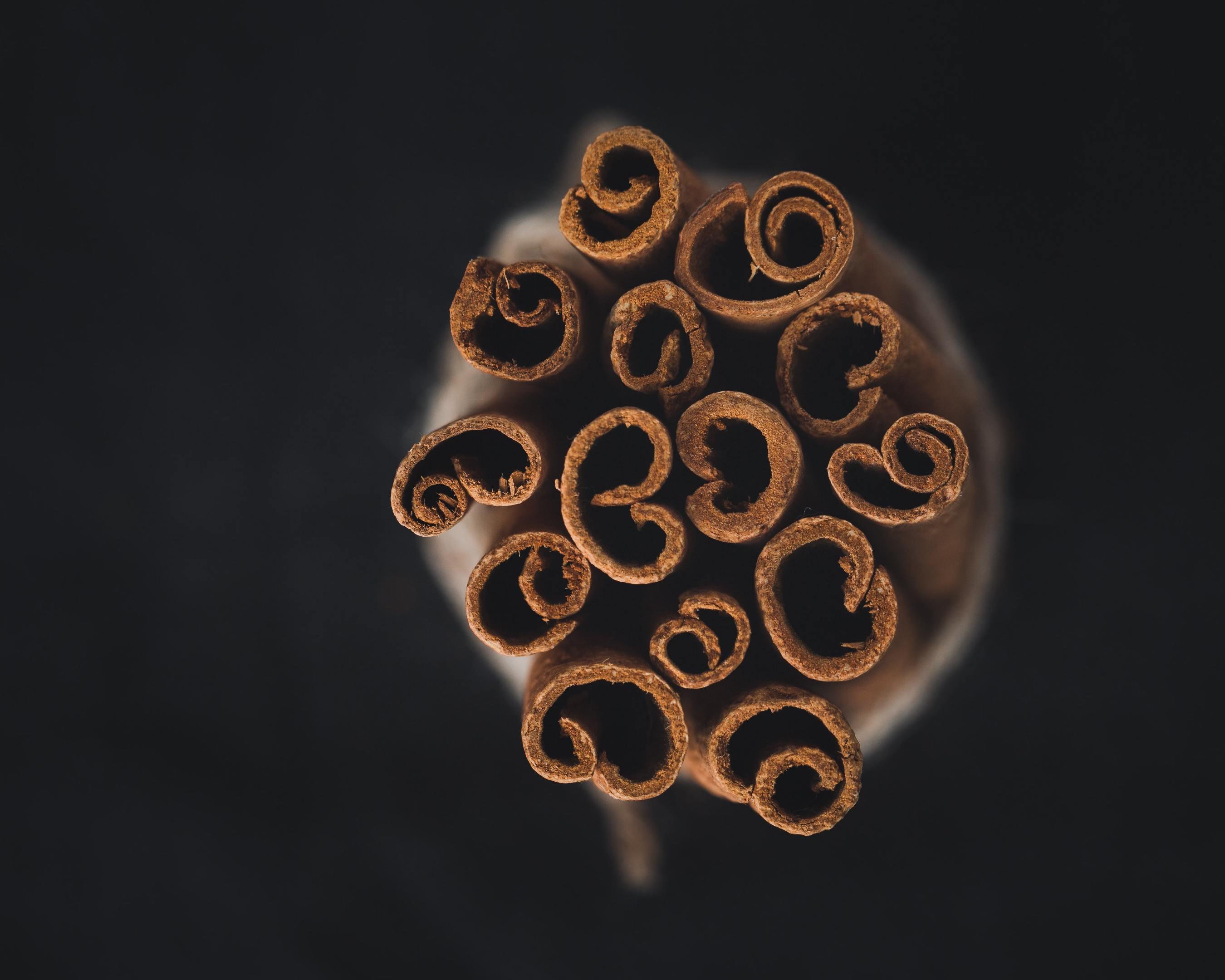 A bundle of fragrant cinnamon sticks on a black background