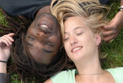 couple laying on grass
