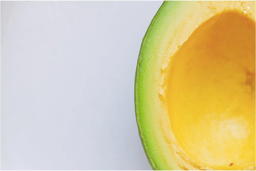 a very close up shot of a cut open avocado