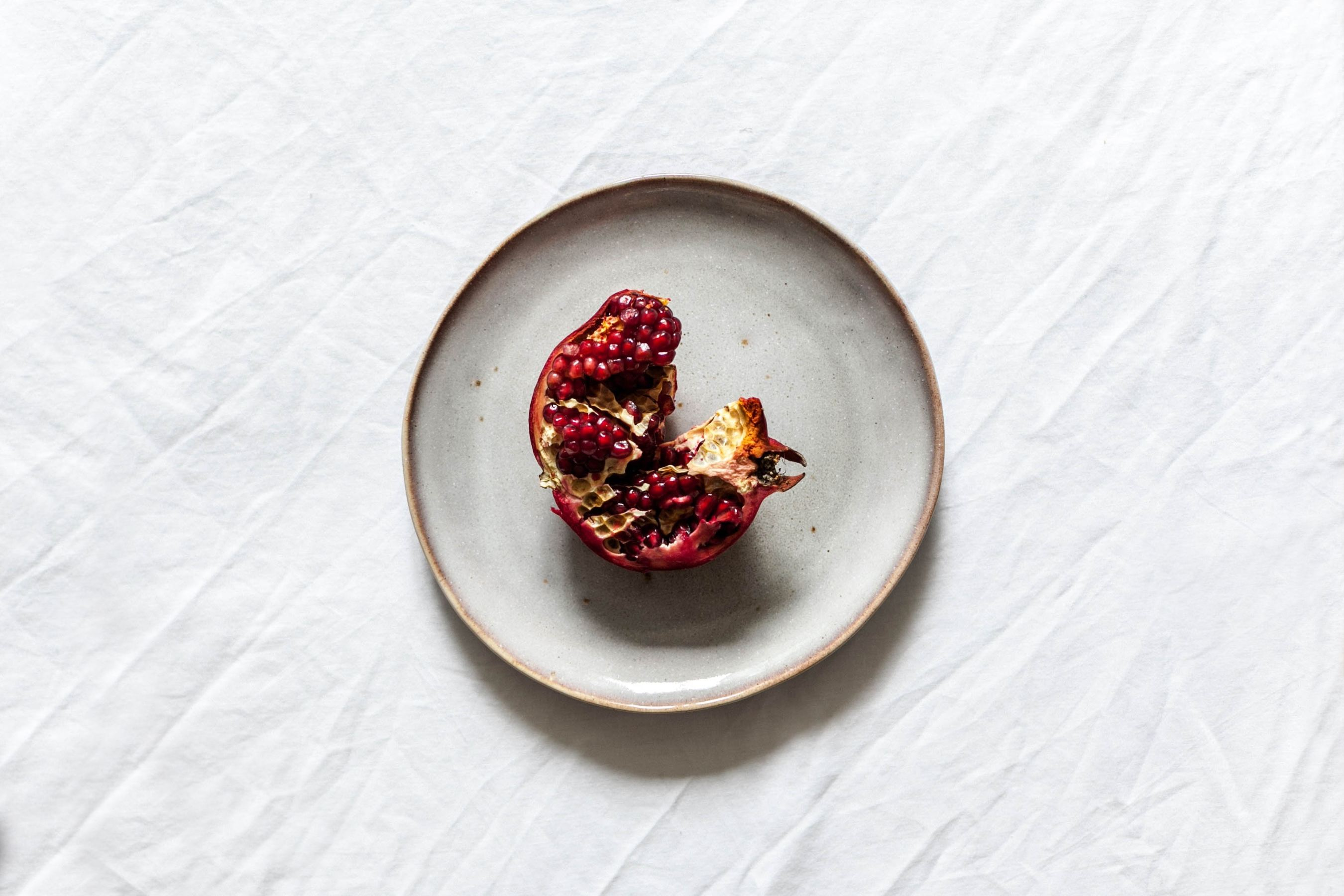 pomegranate on a ceramic white plate