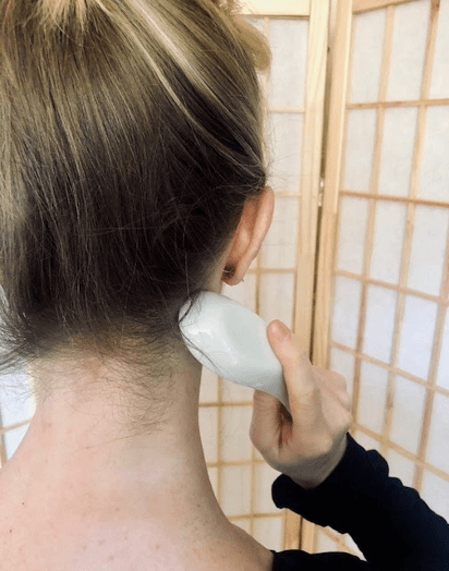 Back neck being gua sha'd