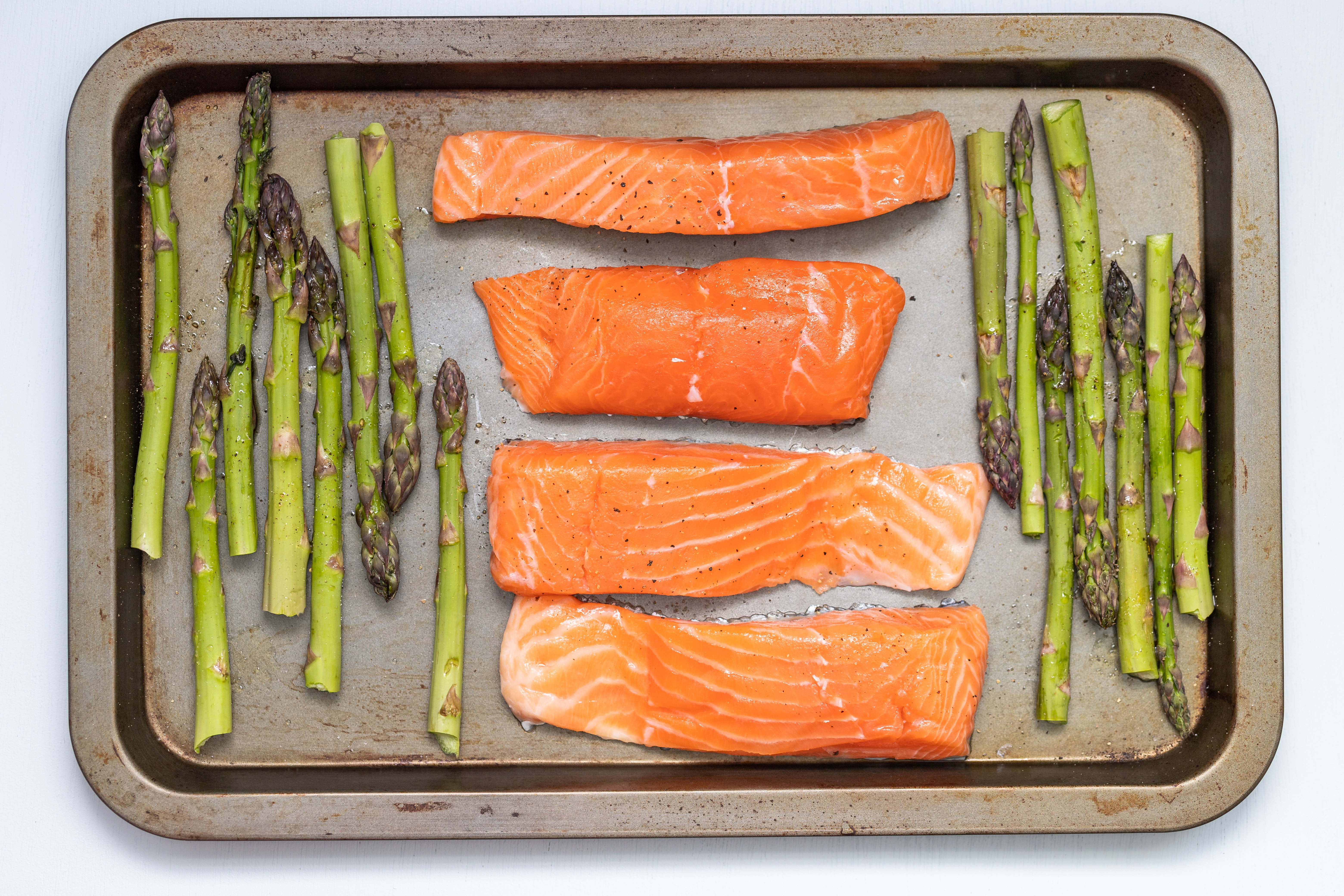 baking sheet with salmon and asparagus