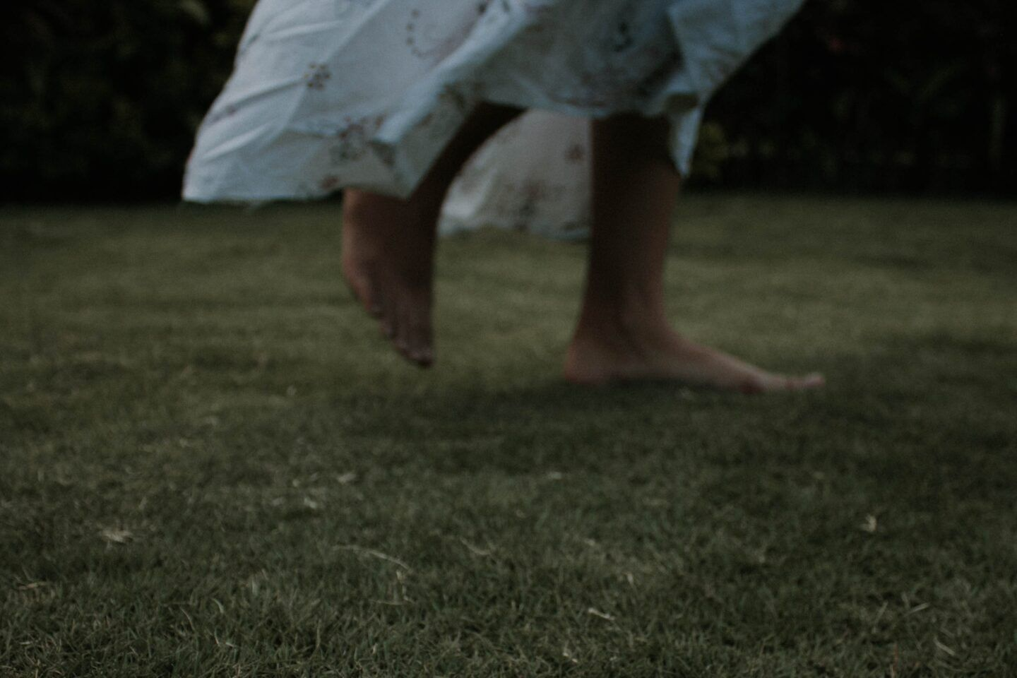 barefoot woman in white dress